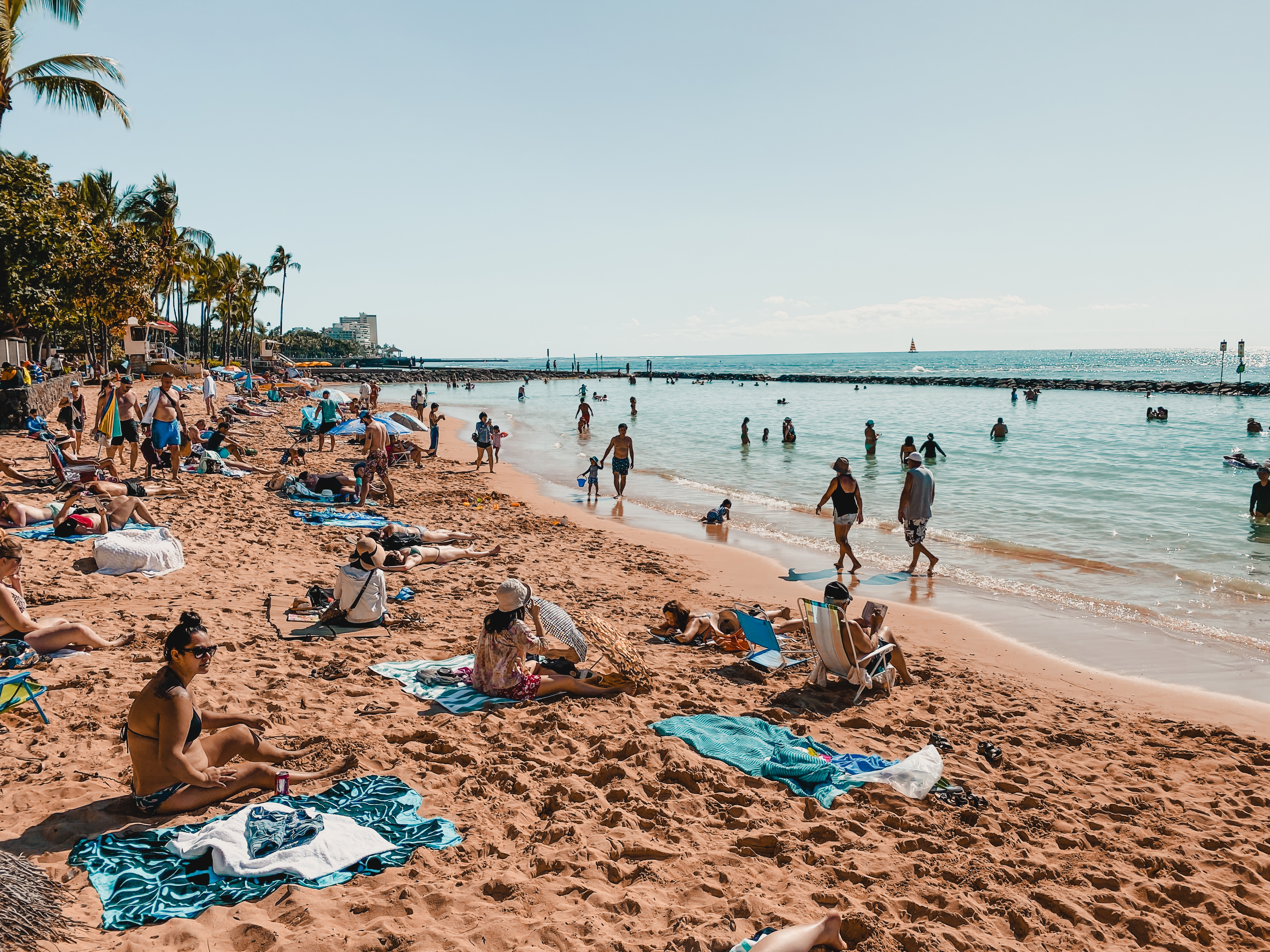 people enjoying the sun at Waikiki beach